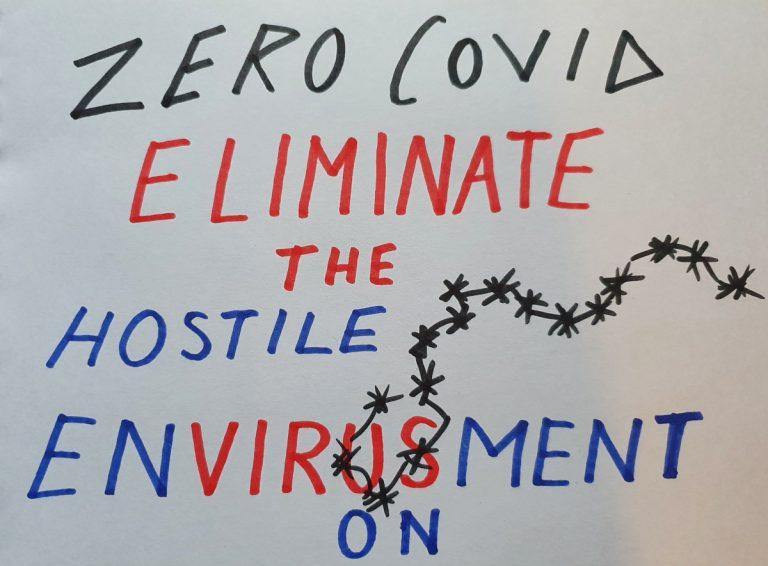 A placard saying 'Zero Covid eliminate the hostile envirusment' (sic)